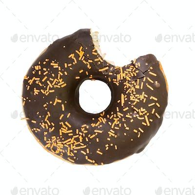 Bitten chocolate donut. Top view.