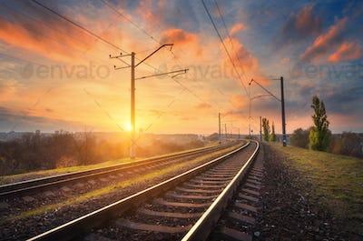 Railway station against beautiful sky at sunset. Industrial land