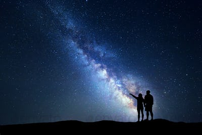 Milky Way with people on the mountain. Landscape