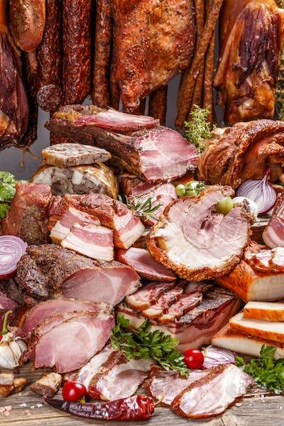 Still life of various smoked pork meat