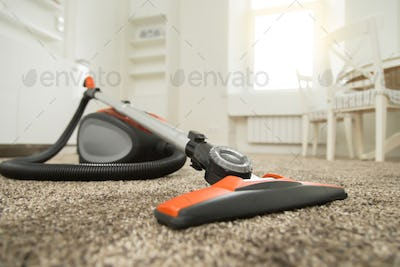 Vacuum cleaner on the carpet