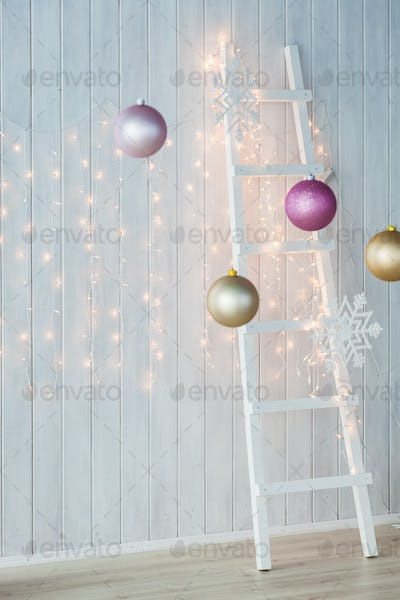 Christmas lights burning on a white wooden background.