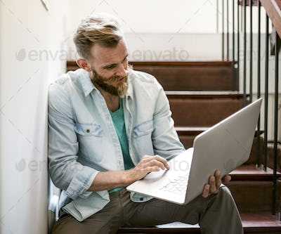 Man Laptop Surfing Social Networking Stairway Concept