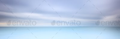 Long exposure photography panorama 3:1 with soft sea and cloudy sky