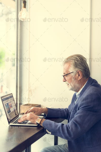 Senior Man Working Coffee Shop Realxation Concept