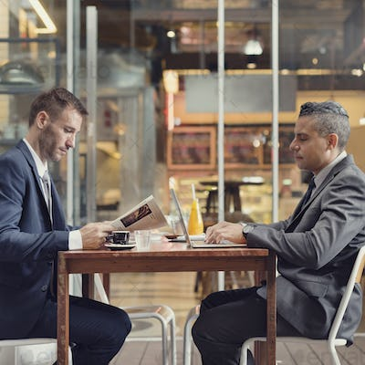 Two Businessmen Cafe Working Laptop Concept