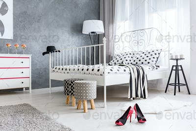 Grey bedroom with window