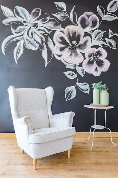 Room with white armchair