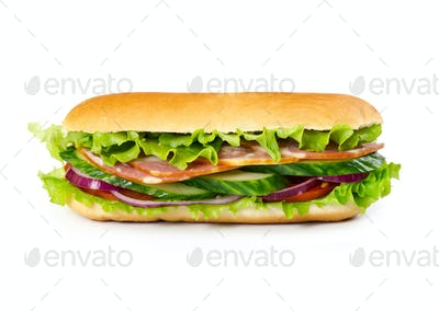 Sandwich with ham, tomato, cucumber, onion and salad leaves
