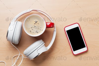 Smartphone, headphones and coffee