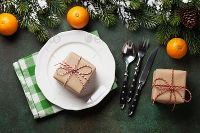 Christmas dinner plate, silverware, fir tree, oranges