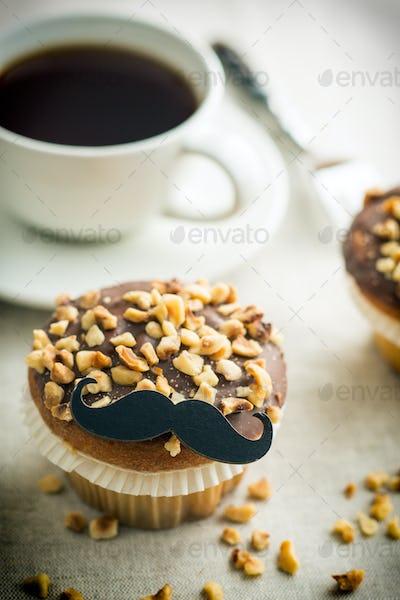 Sweet hazelnut muffin with mustache.