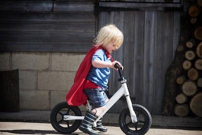 Superhero Baby Boy Ride Bicycle Adorable Concept