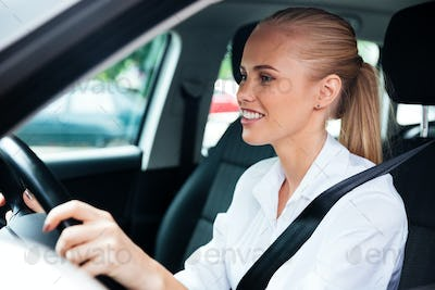 Close up portrait of a business woman driving her car