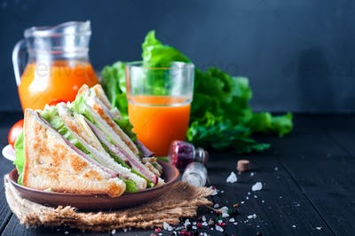 homemade sandwich with salad and juice as a healthy breakfast