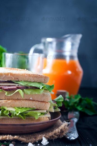 club sandwiches on wood background