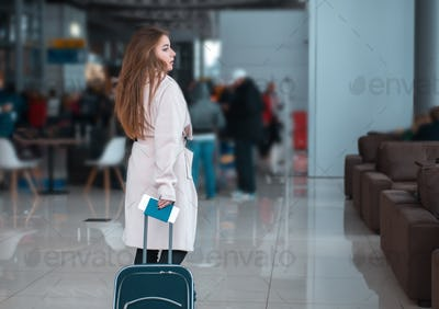 Traveller walking the airport hall.