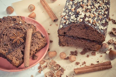 Vintage photo, Gingerbread or dark cake with chocolate on white boards, delicious dessert