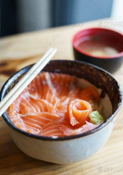 Salmon Donburi serve with miso soup on wooden table