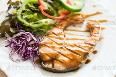 Grilled Teriyaki salmon steak with vegetables