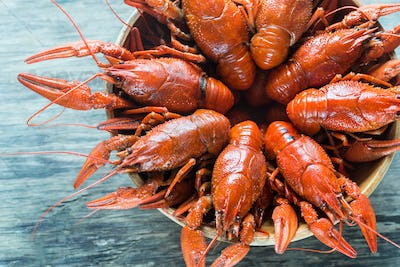 Bowl of boiled crayfish on the wooden table
