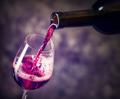 Red wine is the being poured into glass