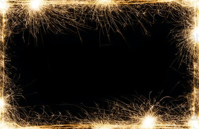 New year party sparklers frame on black background