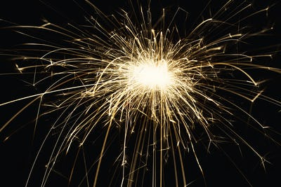New year party sparkler closeup on black background