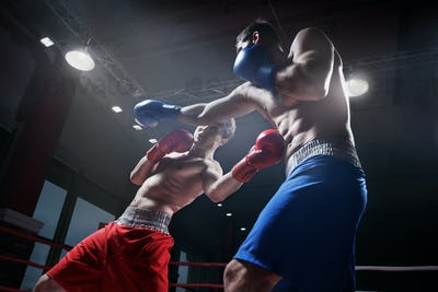 Fighting in boxing ring