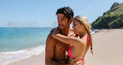 Affectionate young couple embracing on the beach