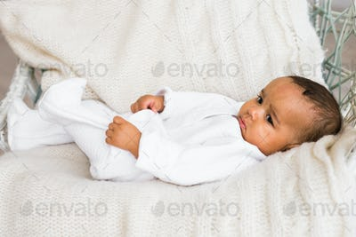 Portrait of a mixed race baby boy