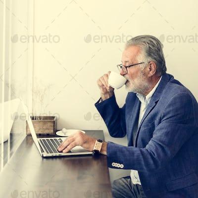 Senior Man Working Coffee Shop Realxation Concept