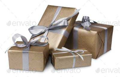 Christmas holiday gift boxes in golden paper isolated on white