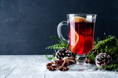 Mulled wine and spices on wooden background.