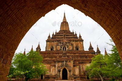 Architectural detail of a temple in Bagan with stone arch entrance