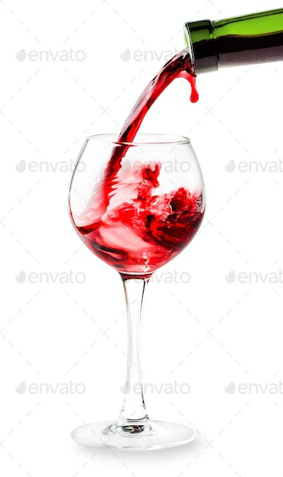 Red wine pouring into the glass