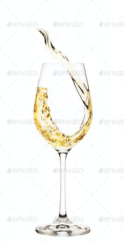Splash of white wine in glass