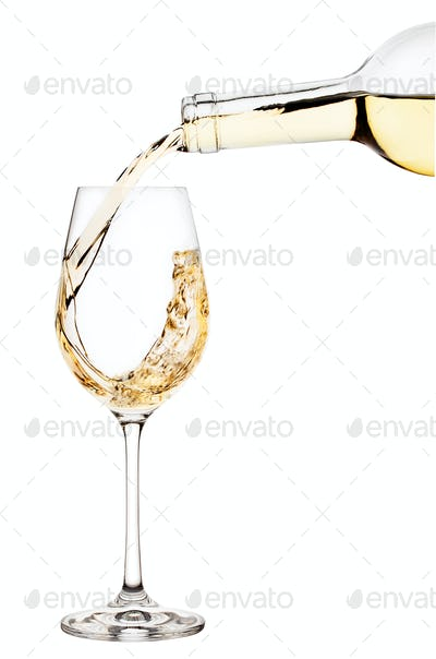 White wine is poured into wine glass