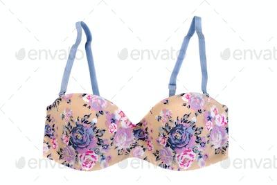 Beige bra with floral pattern.