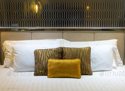 pillows on beds in hotel