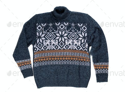 Knitted sweater with snowflake pattern.