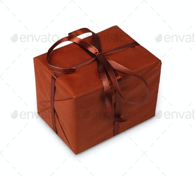 Christmas holiday gift box in brown paper isolated on white