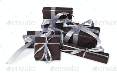 Christmas holiday gift boxes wrapped in paper, isolated on white