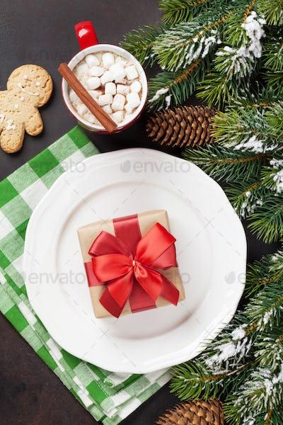 Christmas dinner plate, silverware, fir tree, gift