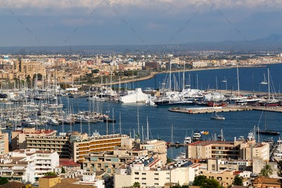 port with yachts and the city of Palma De Mallorca