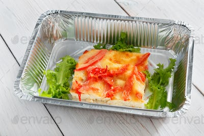 Healthy food in boxes, diet concept. Omelette