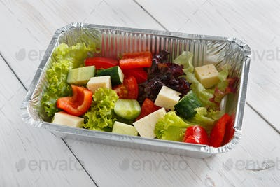 Healthy food in boxes, diet concept. Greek salad