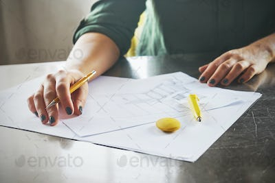 Architect woman sketching in her office
