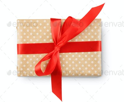 Christmas holiday gift box in spotted paper isolated on white