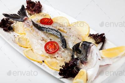 white fishand and  lemon